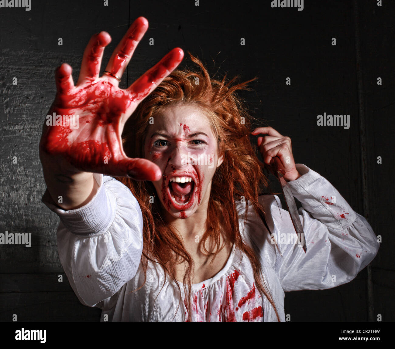 Woman in Horror Situation With Bloody Face - Stock Image