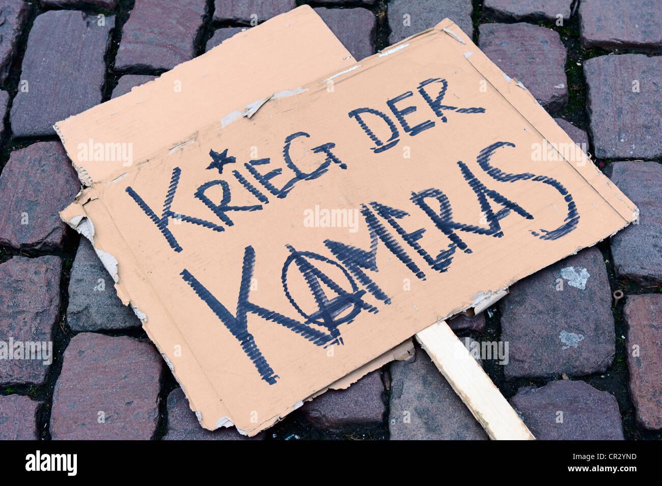 Sign, Krieg der Kameras, German for War of the cameras, protest against the use of surveillance video, demonstration - Stock Image