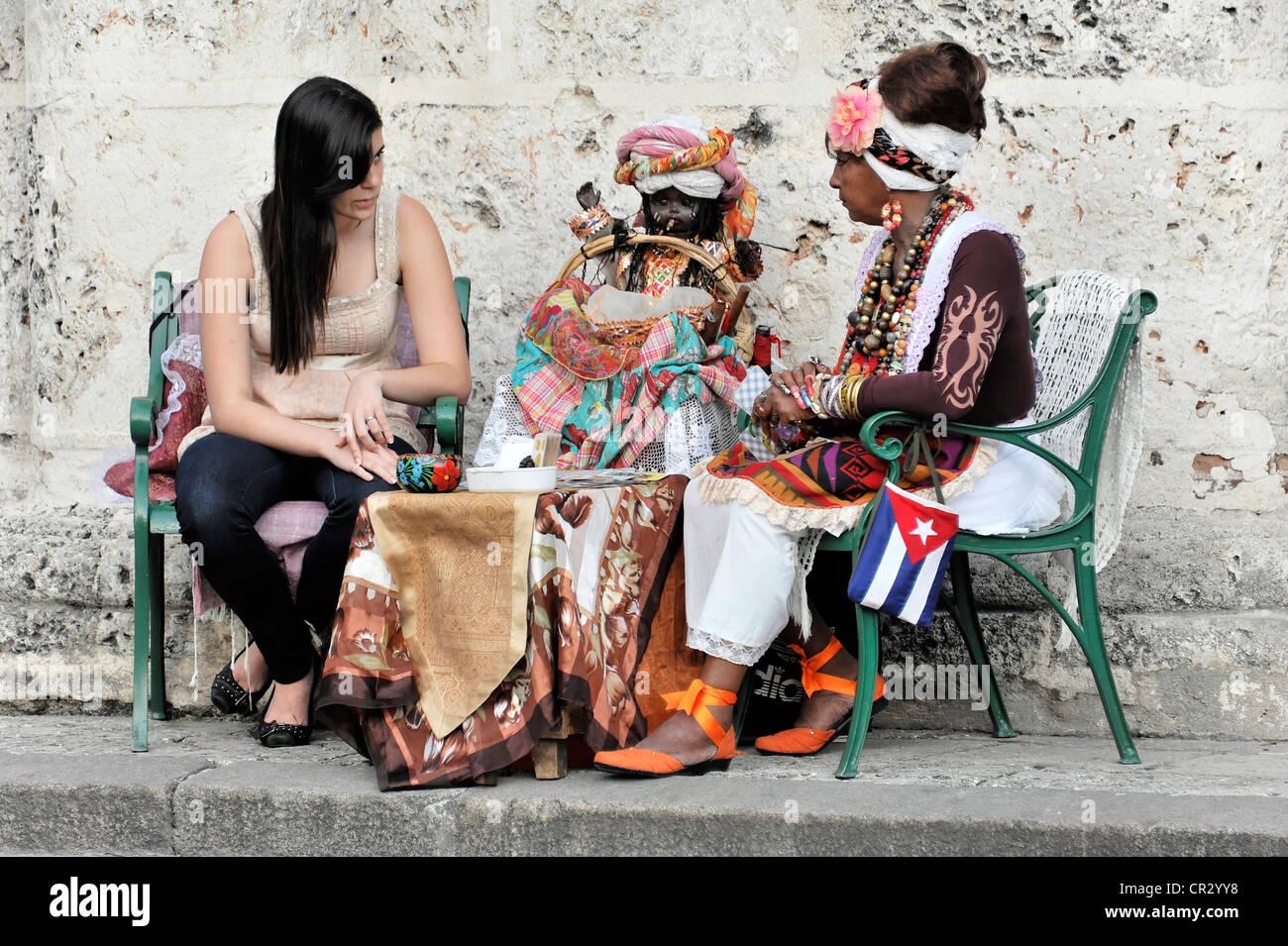 Fortune teller with a tourist, Plaza de la Catedral, Havana, Cuba, Greater Antilles, Caribbean, Central America, - Stock Image