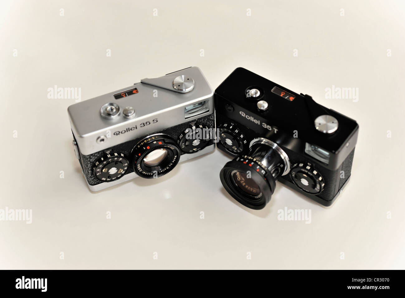 Analogue or film cameras, Rollei 35, Rollei 35s, left and Rollei 35T, right, miniature viewfinder camera, built Stock Photo