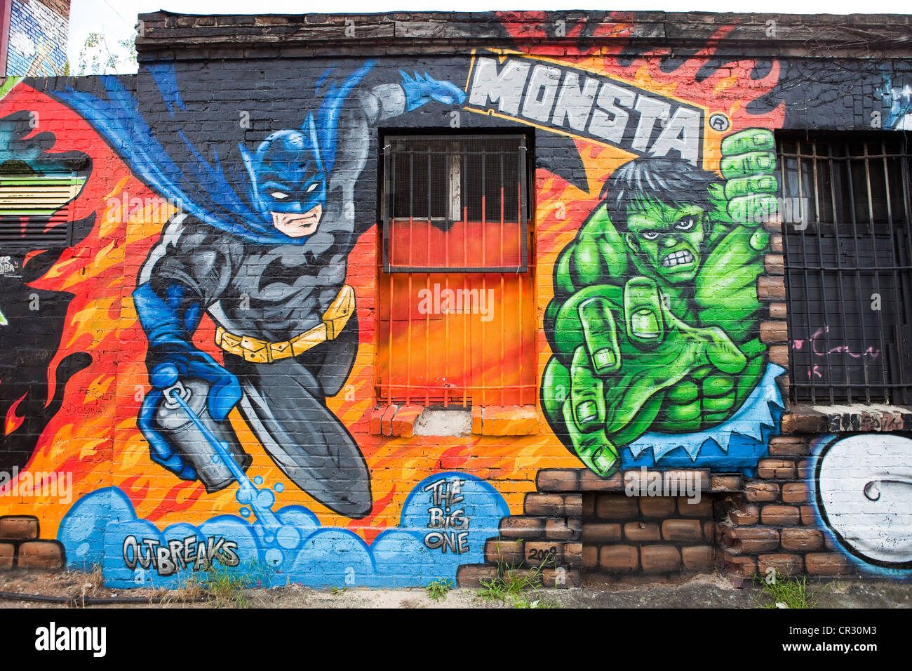 Germany, Berlin, Friedrichshain District, mural (tag) with the superheroes Batman and Hulk - Stock Image