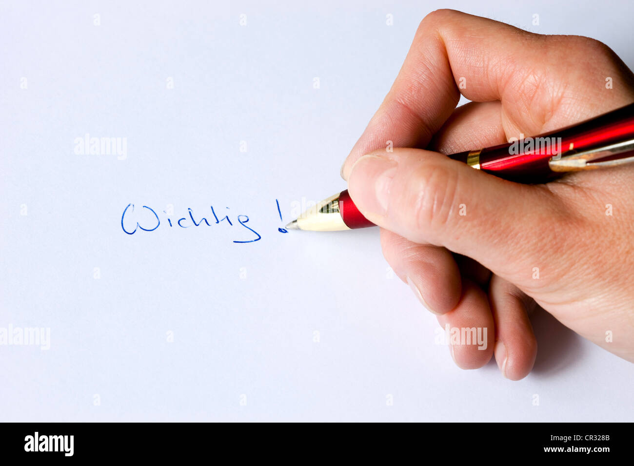 Note Wichtig or important written in ballpoint pen - Stock Image