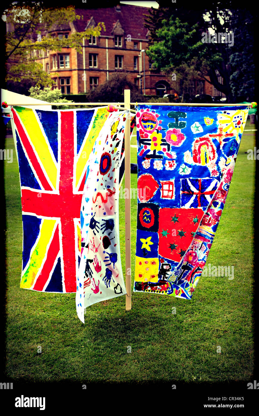 Instagram style Pix of Queen's Jubilee flags designed by children on show at Sherborne's town party - Stock Image