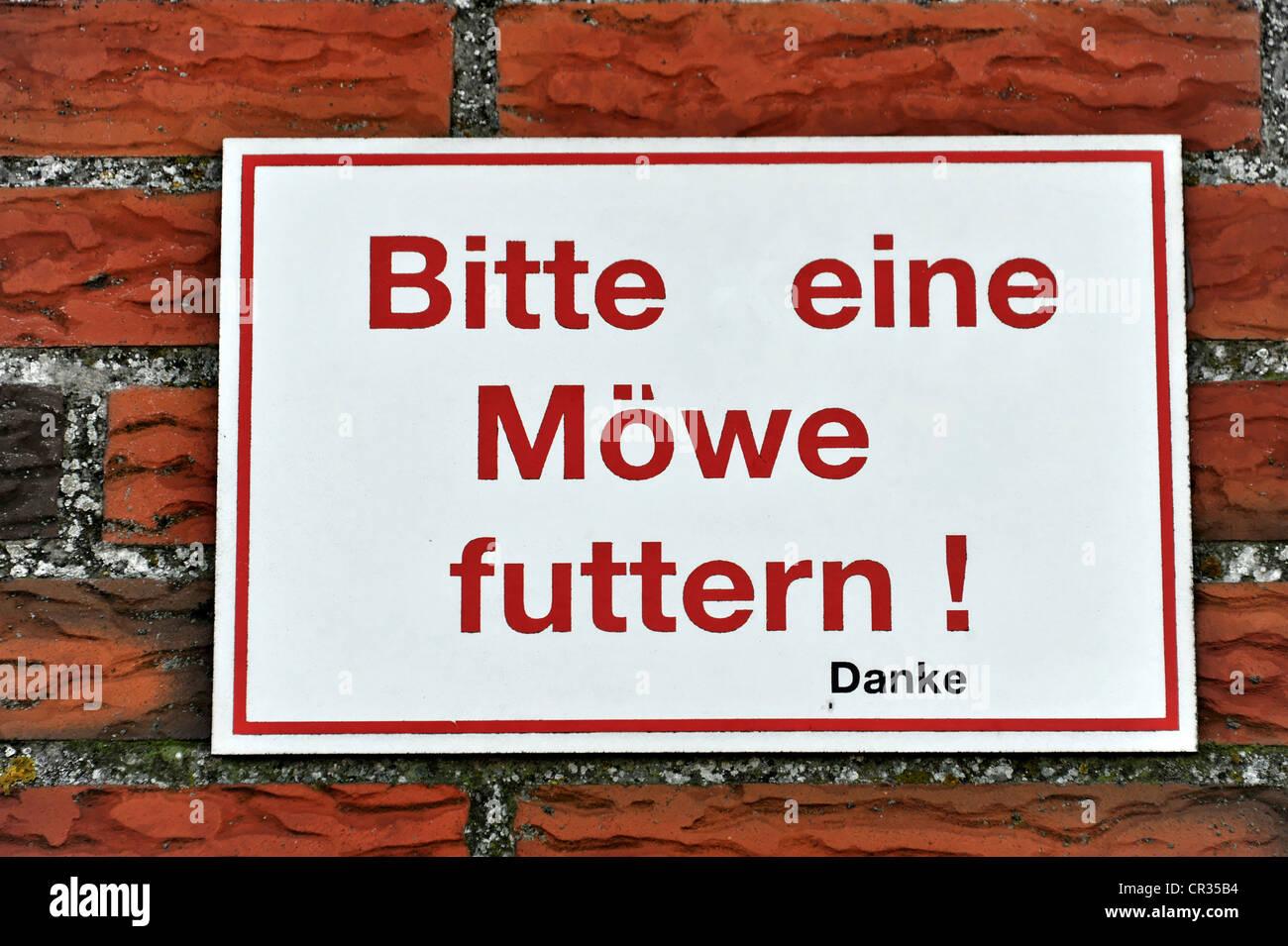 Bitte eine Moewe futtern, Please feed a seagull, altered sign at a restaurant, Eidersperrwerk, Eider Barrage - Stock Image