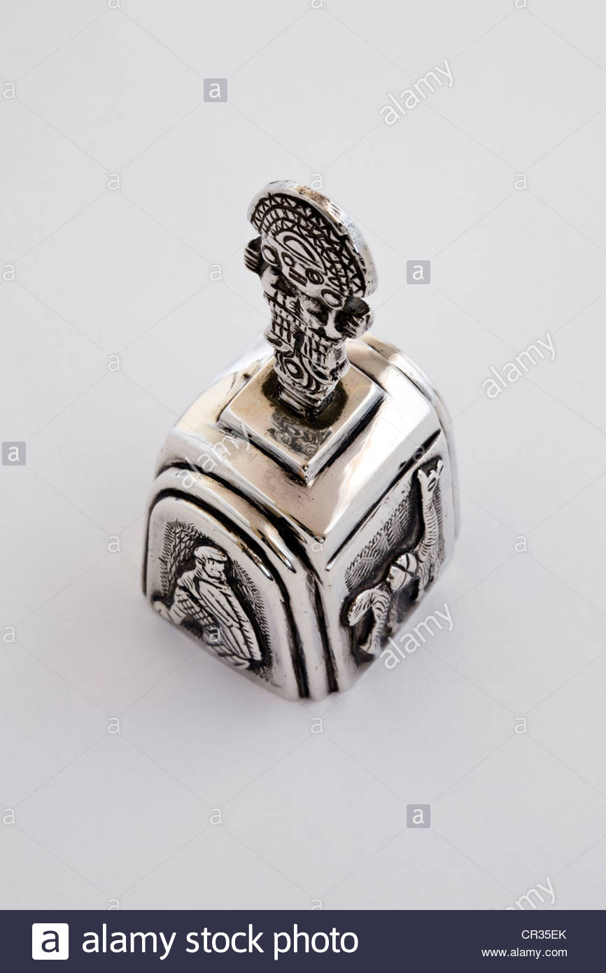 Silver Inca Bell With Traditional Symbols On White Background Stock