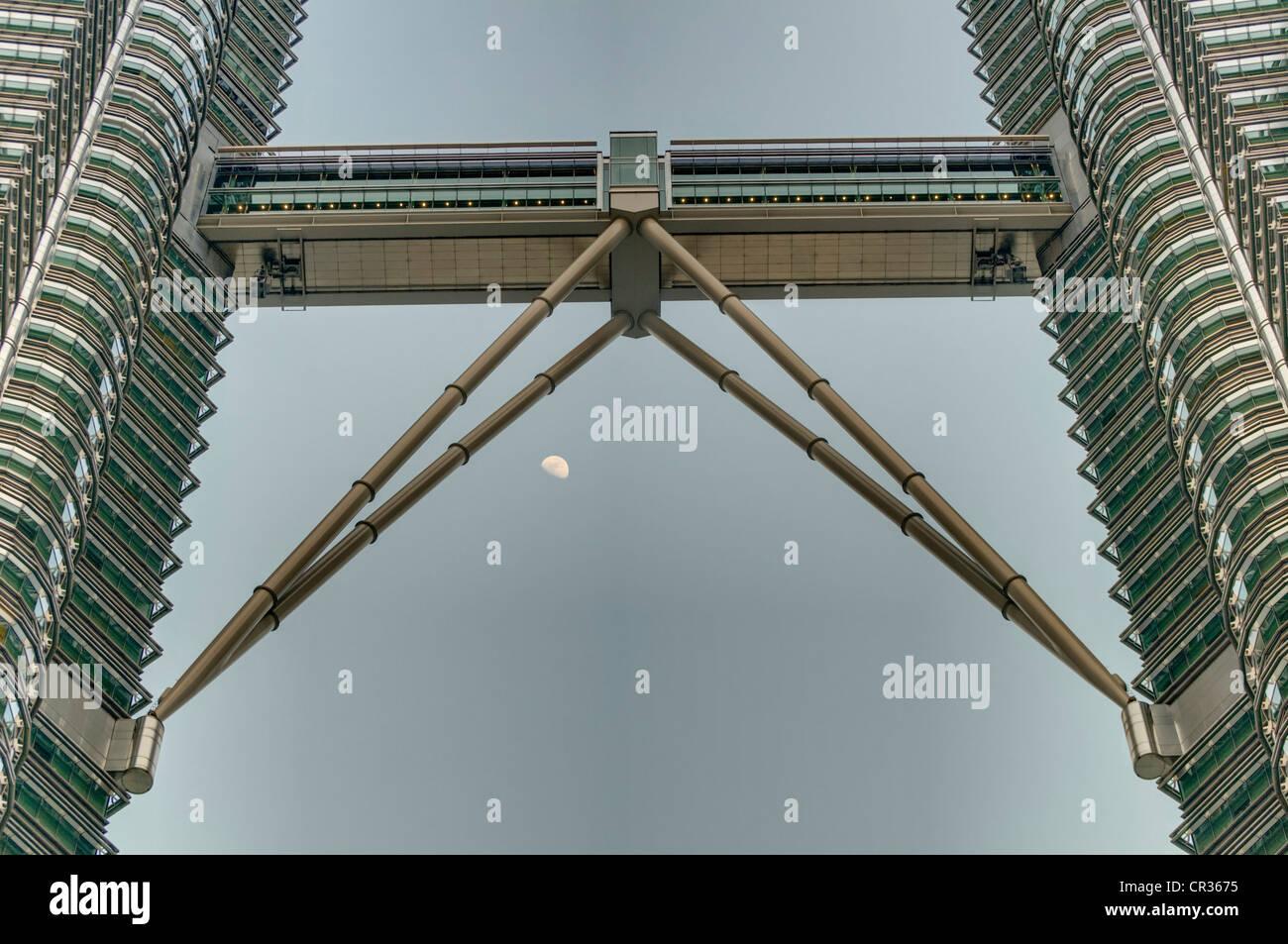Skybridge of the Petronas Towers and moon, Kuala Lumpur, Malaysia, Southeast Asia - Stock Image