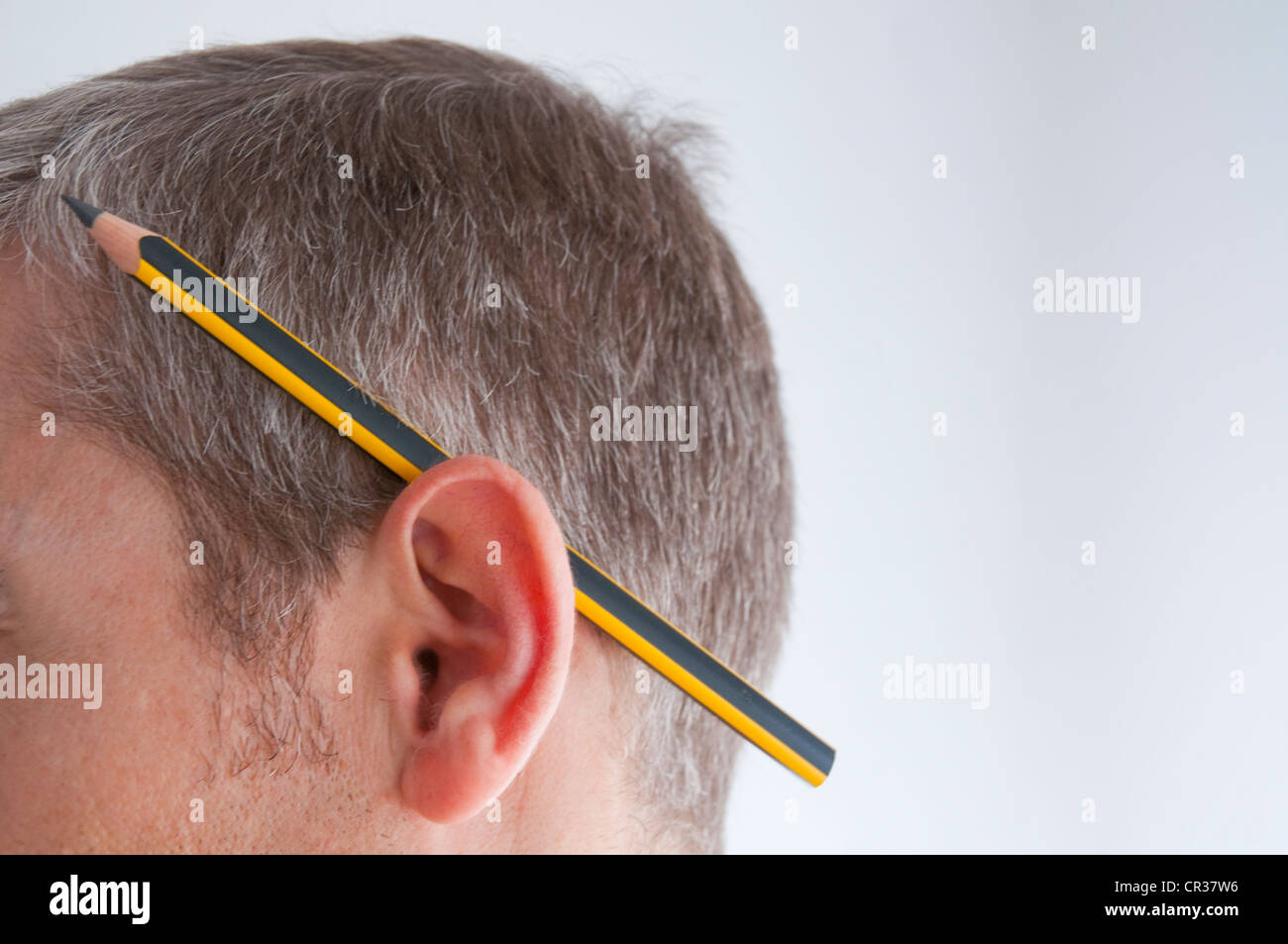 Man with pencil behind his ear. Close view. - Stock Image