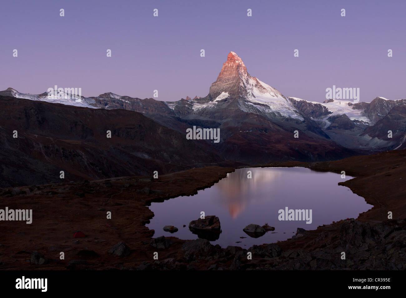 Mt Matterhorn is reflected in Stellisee Lake before sunset, Zermatt, Canton Valais, Switzerland, Europe, PublicGround Stock Photo