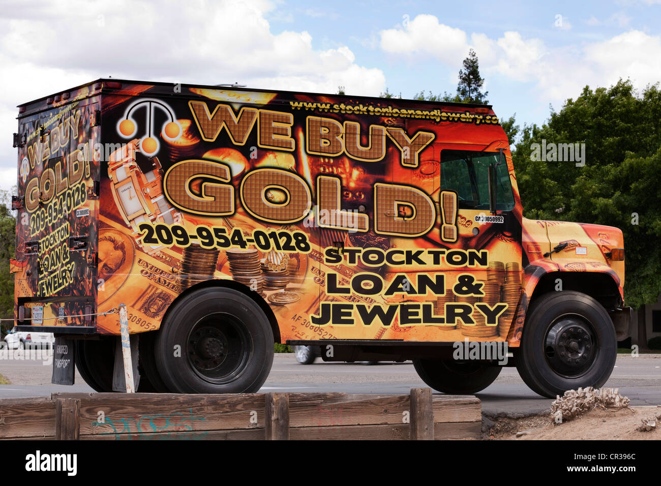 We Buy Gold ad on truck - Stock Image