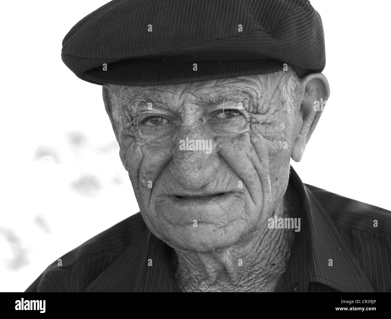 Old man outside the entrance to Garni Temple, Garni, Kotayk, Armenia - Stock Image