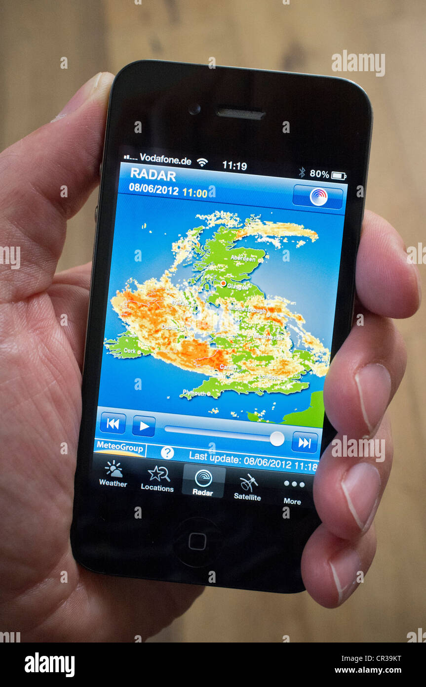 Severe storm over the United Kingdom shown on radar image using weather forecast App on iPhone smartphone - Stock Image