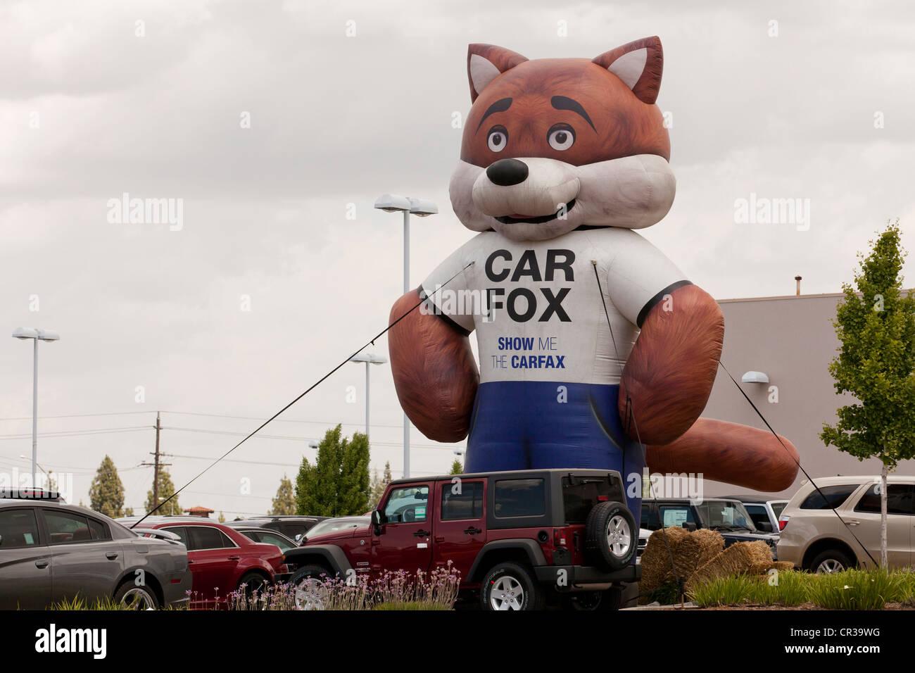Carfax Carfox balloon display at a used car sales lot - California ...