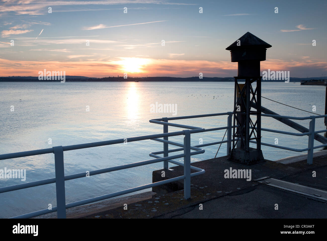 Old fog horn on the pier in Meersburg on Lake Constance, overlooking the lake towards Konstanz at sunset, Baden - Stock Image
