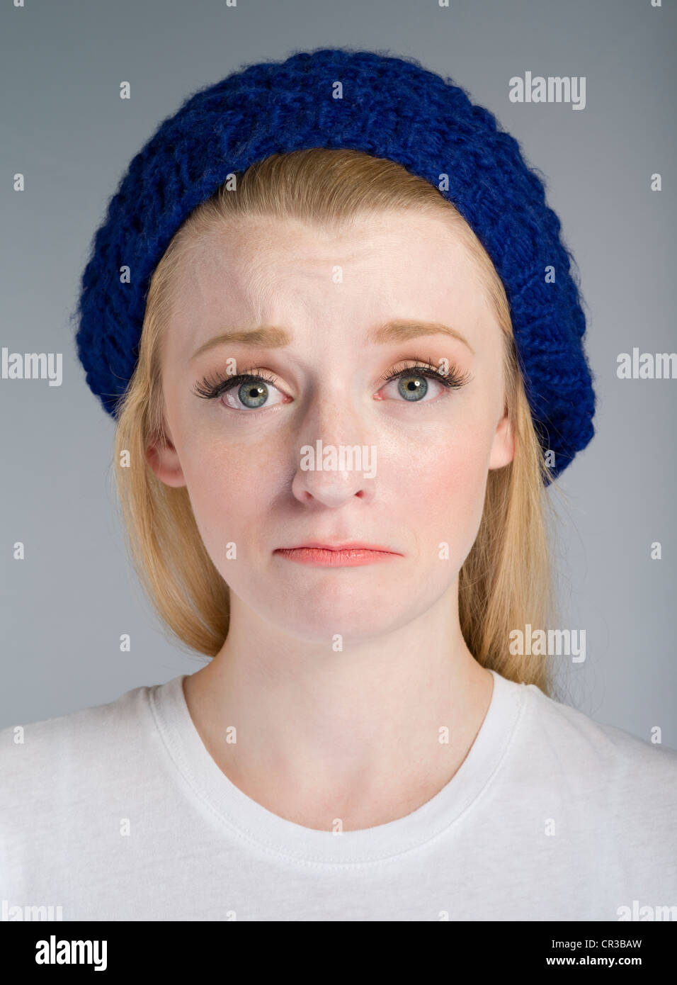 Pale complexion Caucasian girl with blonde / blond hair in her twenties - Stock Image