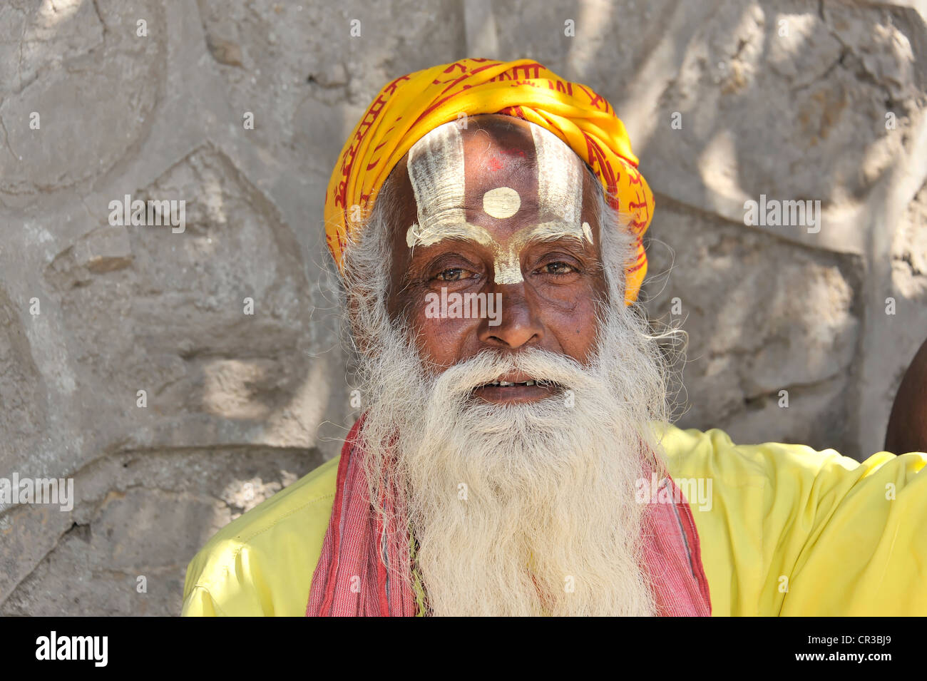 Sadhu holy man with brightly painted face and beard, portrait, Hinduism, Makhan Tole square in front of the Krishna Stock Photo