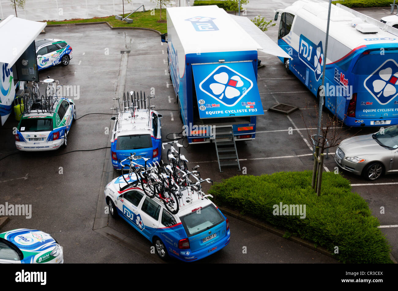 Support vehicles for the 2012 Tour de France in a Calais hotel car park. - Stock Image