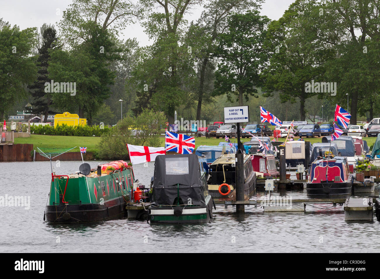 Longboats moored at Billing Aquadrome Flying Union Jack for the Queens Jubilee - Stock Image