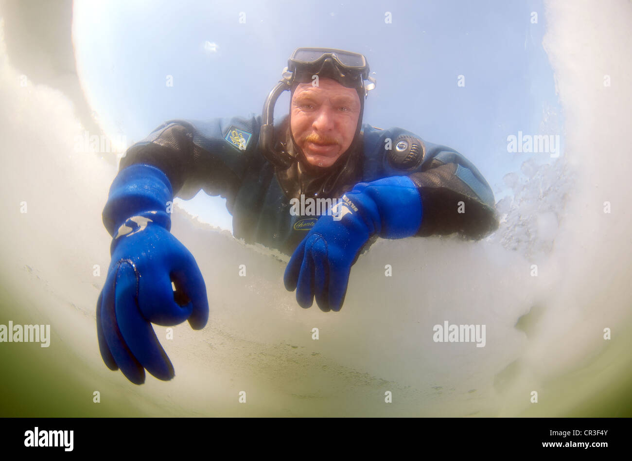 Diver's hand giving the OK sign, subglacial diving, ice diving, in the frozen Black Sea, a rare phenomenon - Stock Image