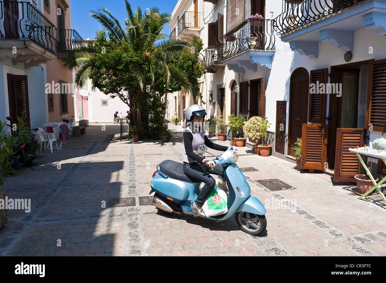 Italy Sicily Aeolian Islands listed as World Heritage by UNESCO Lipari Island Lipari scooter in a street of historical Stock Photo