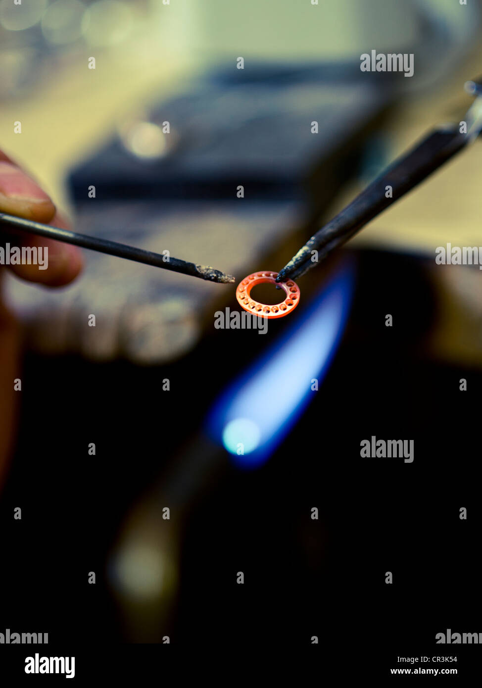 Jeweller making a ring - Stock Image