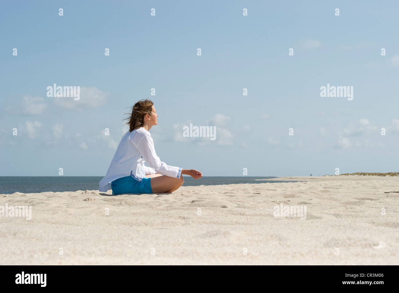 Woman on the beach, List, Sylt island, Schleswig-Holstein, Germany, Europe - Stock Image