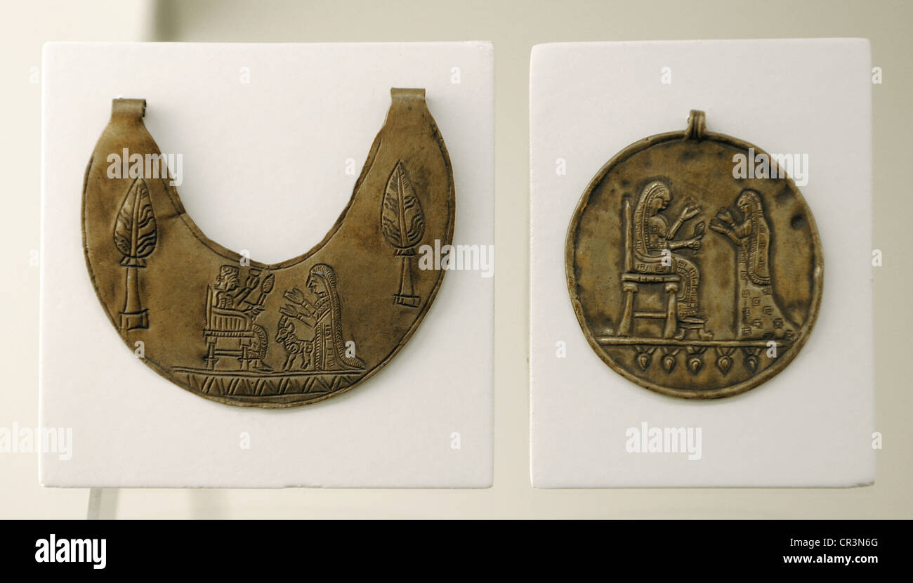 Urartu civilization. Pectoral decorated with god Haldi on the throne and his wife Arubani and medaillon with seated - Stock Image