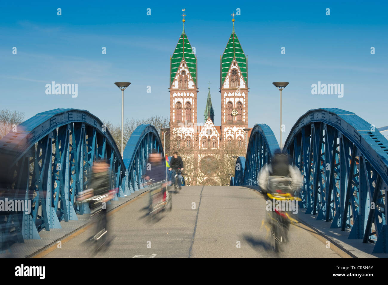 Cyclists, motion blur, Blaue Bruecke bridge, Freiburg im Breisgau, Baden-Wuerttemberg, Germany, Europe - Stock Image