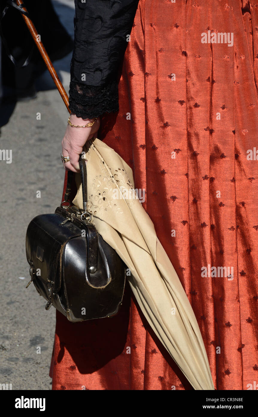 Parasol and Handbag of French Woman Wearing Traditional Provençal Costume Aix-en-Provence Provence France - Stock Image