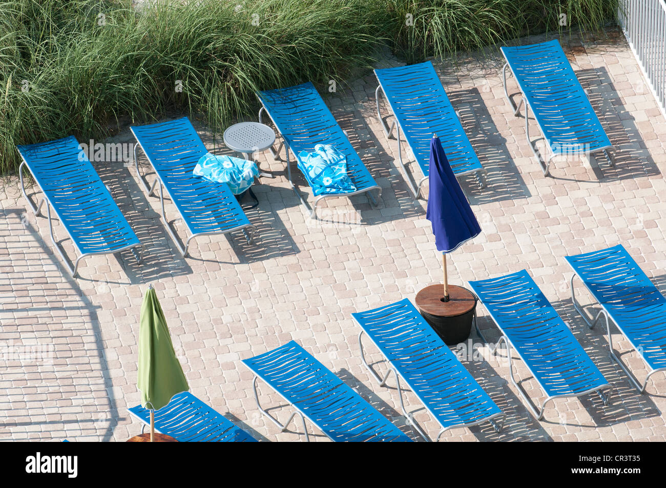 Reserving a sunbed with a beach towel a German habit - Stock Image
