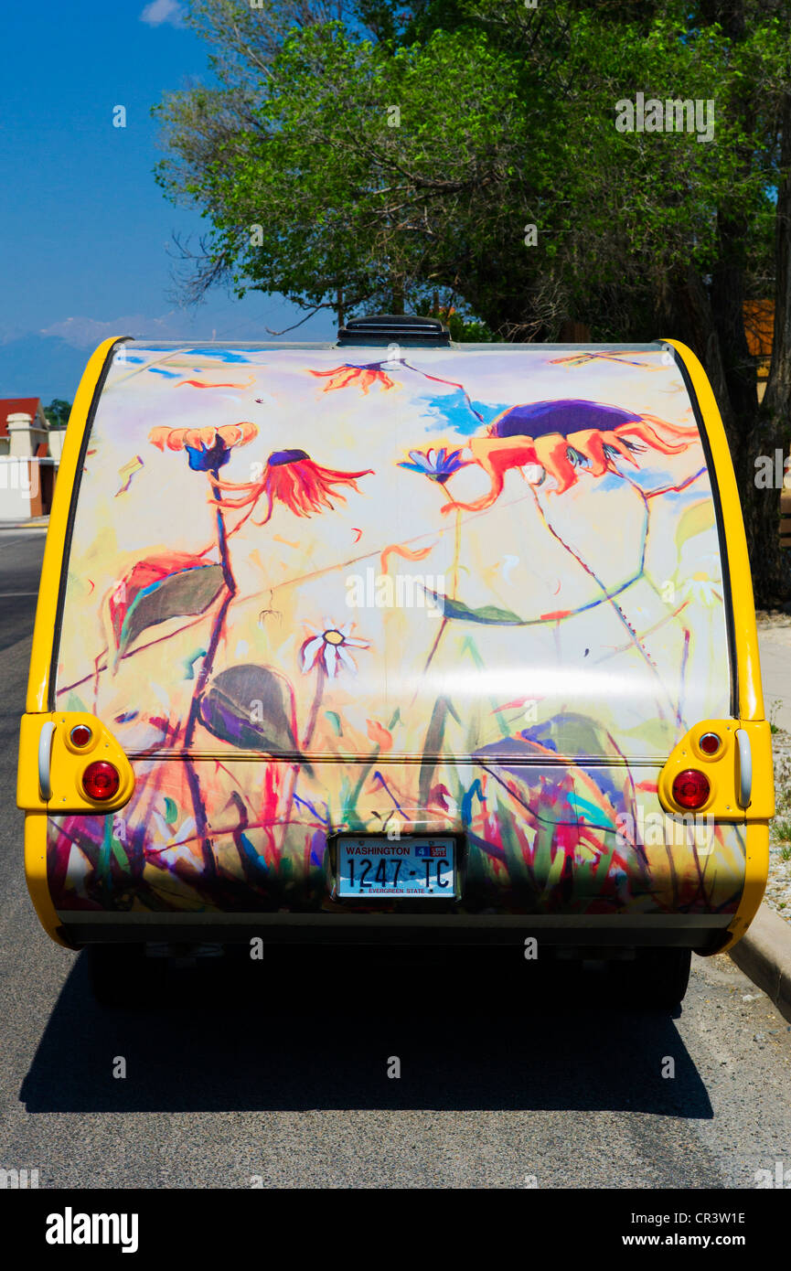 Artwork mural hand painted on a small recreational vehicle camper trailer - Stock Image