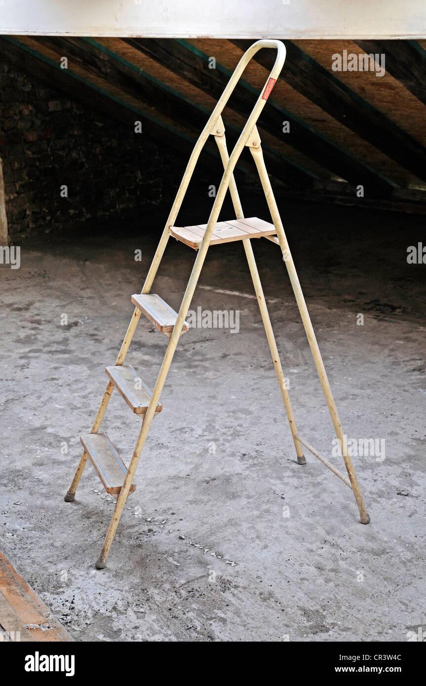 Step ladder, building site, old building refurbishment - Stock Image