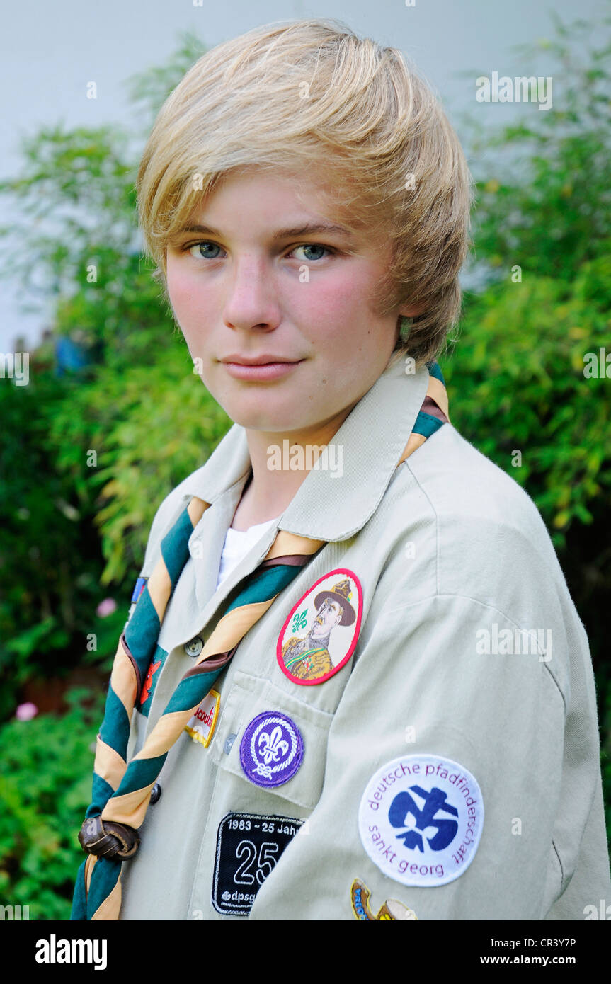 Boy, 13, wearing a Scouts uniform with badges, neckerchief, Gelsenkirchen, North Rhine-Westphalia, Germany, Europe - Stock Image