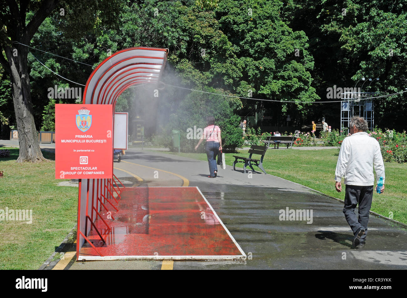 Public water sprinkling system, hot weather, water, cooling, summer, Bucharest, Romania, Eastern Europe, Europe, - Stock Image
