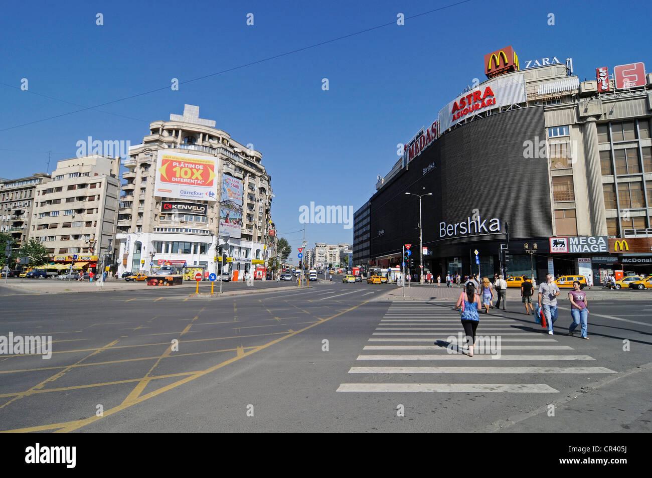 Shopping centre, street scene, billboards, Piata Unirii square, Bucharest, Romania, Eastern Europe, Europe, PublicGround - Stock Image