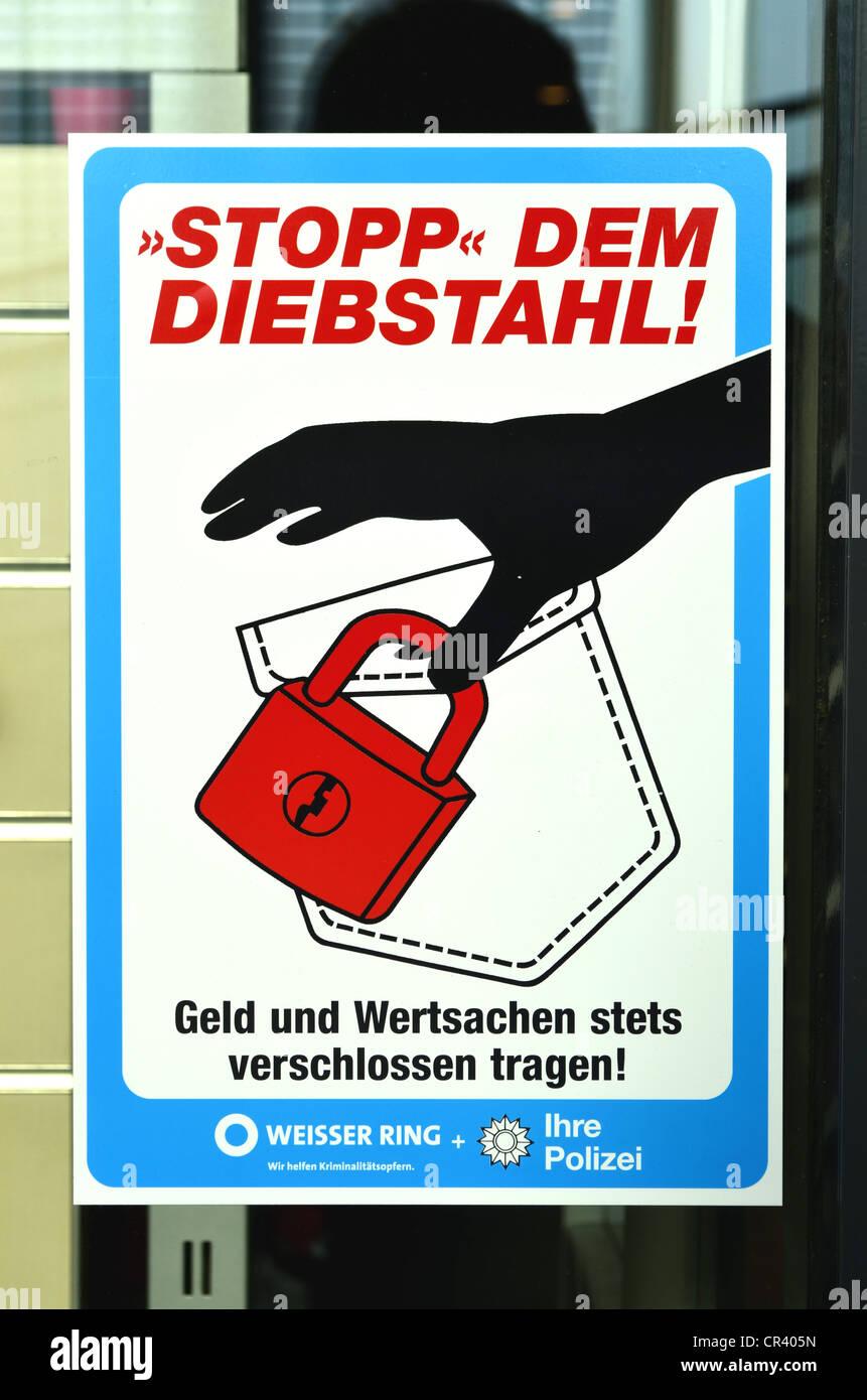 'Stopp dem Diebstahl, Geld und Wertsachen stets verschlossen tragen', German for 'stop theft, always - Stock Image