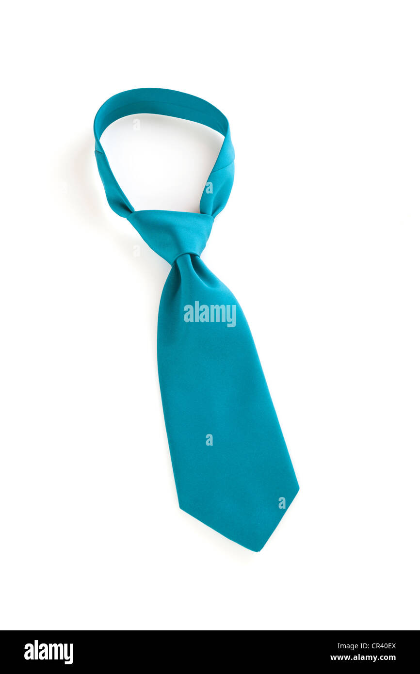 Jade green necktie with a Windsor knot, over white. - Stock Image