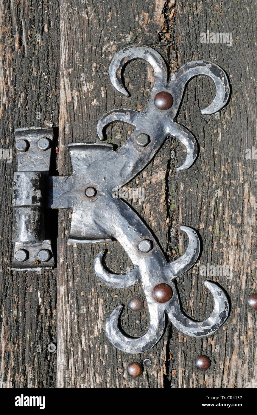 Old metal fittings on a wooden door, hinge, Ratingen, Dusseldorf, North Rhine-Westphalia, Germany, Europe, PublicGround Stock Photo