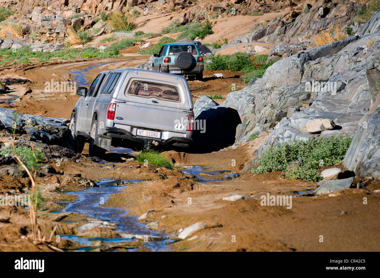 Car on a road, crossing a river, Richtersveld National Park, Northern Cape, South Africa, Africa - Stock Image