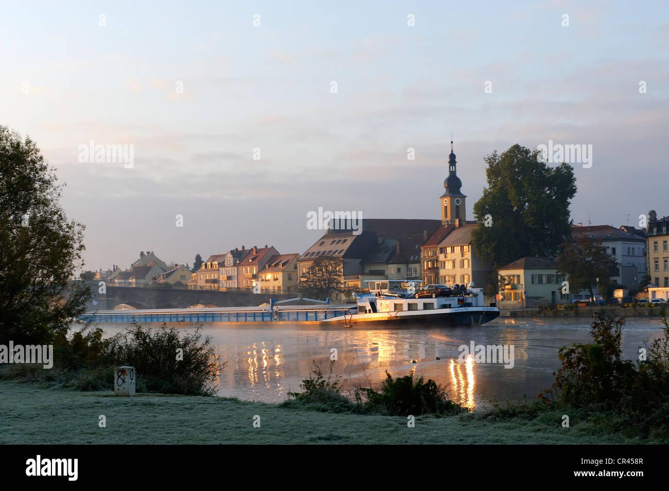 Banks of the Main river with the Catholic Church of St. John, Kitzingen, Lower Franconia, Franconia, Bavaria, Germany, - Stock Image
