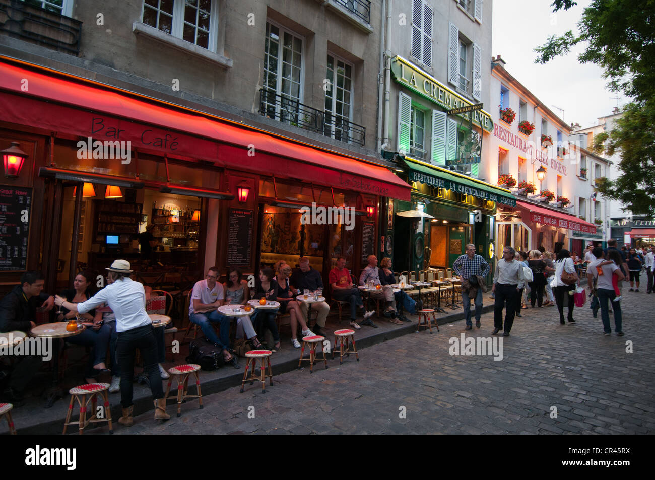 People In Street Restaurants In Montmartre Paris Stock Photo