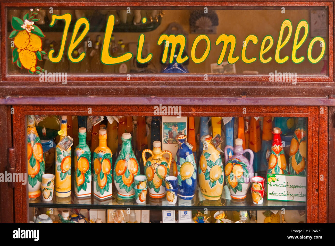 Italy: Window of shop specializing in Limoncello, locally made lemon liqueur, in village of Amalfi on Amalfi Coast - Stock Image