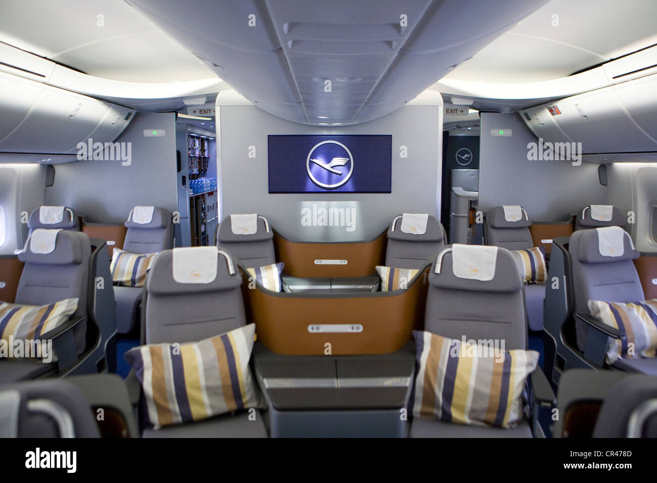 the business class section of a lufthansa boeing 747 8 stock image