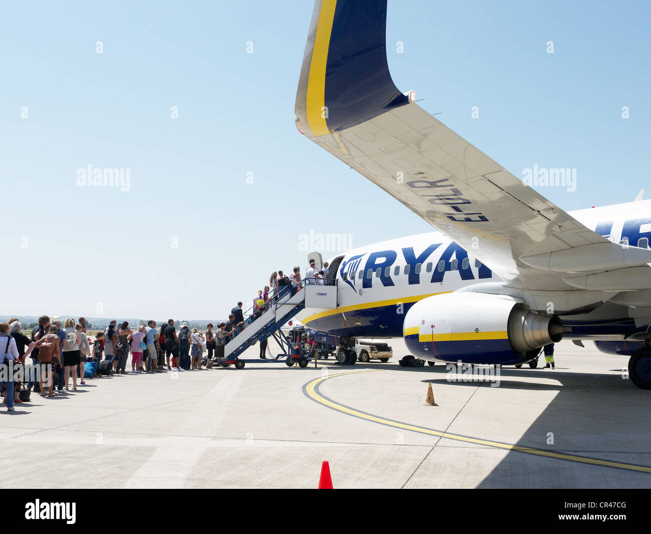 Ryanair passengers in a queue at the airfield waiting to board an airplane, Frankfurt-Hahn Airport, Rhineland-Palatinate - Stock Image