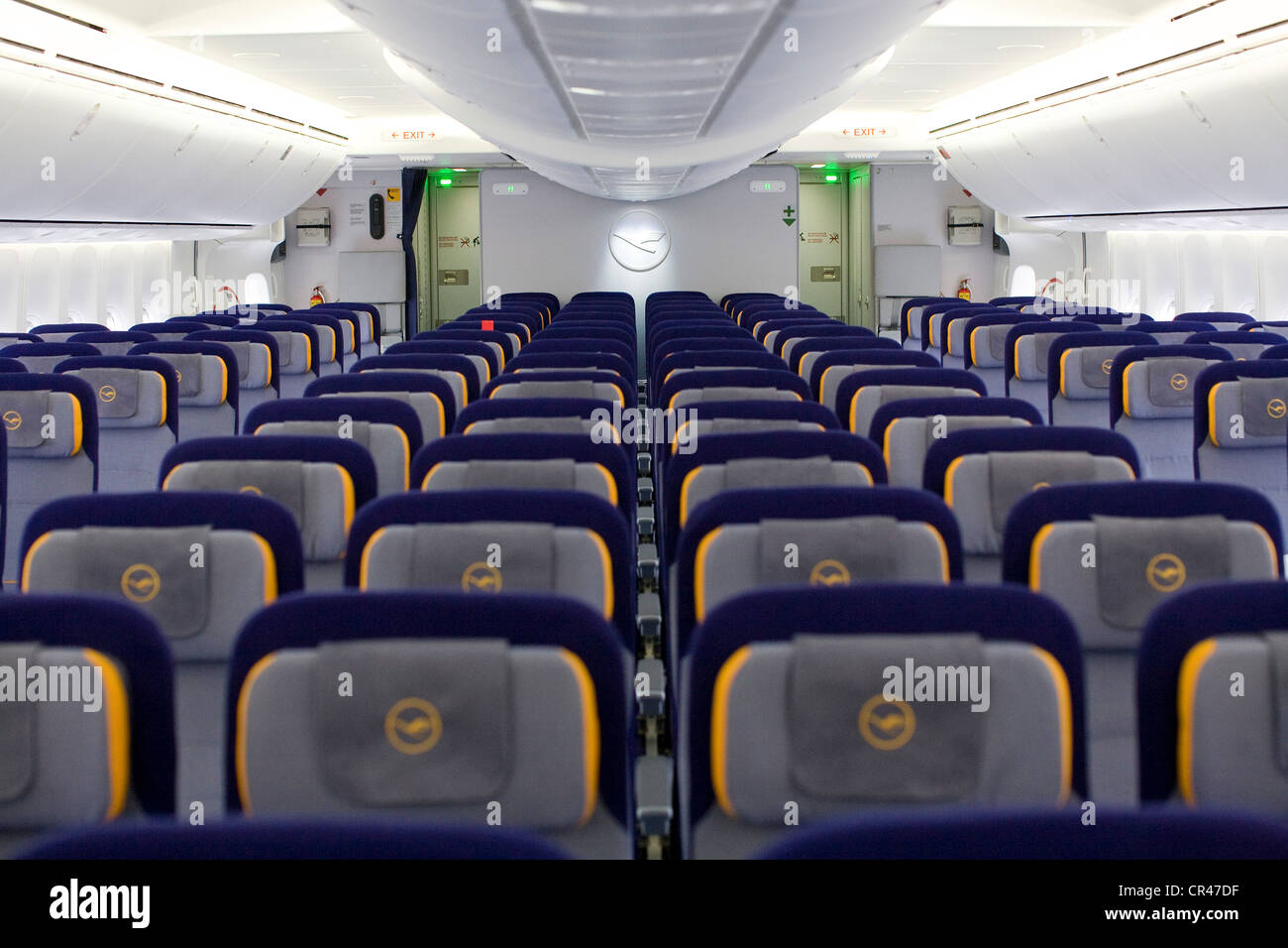 the economy class section of a lufthansa boeing 747 8 stock image