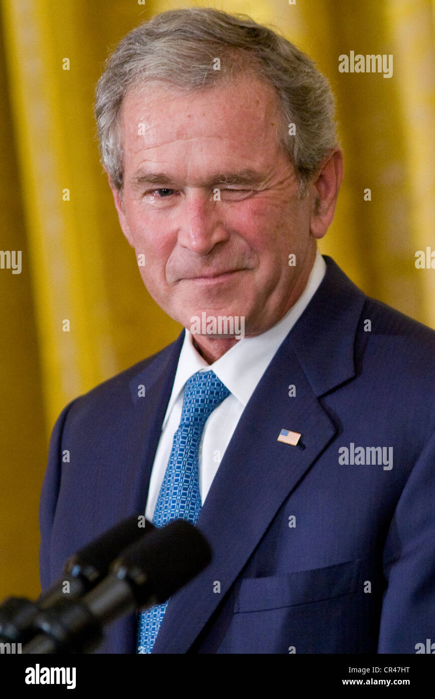 President George W. Bush at a White House ceremony to unveil his official portrait. Stock Photo
