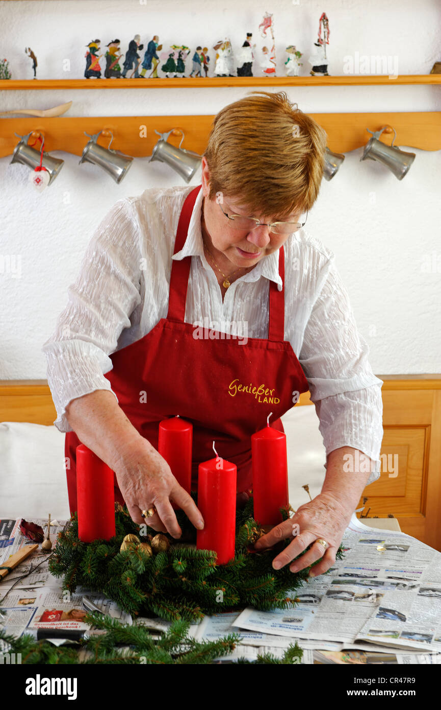 Woman crafting an Advent wreath - Stock Image
