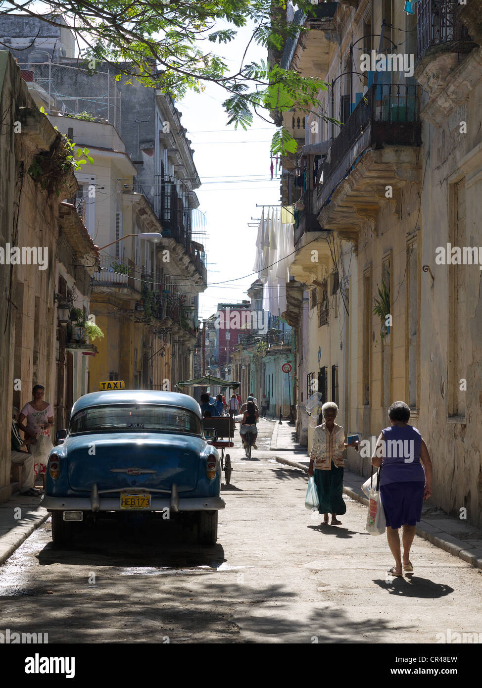 Street scene with vintage cars and passersby in Old Havana, Cuba, Latin America Stock Photo