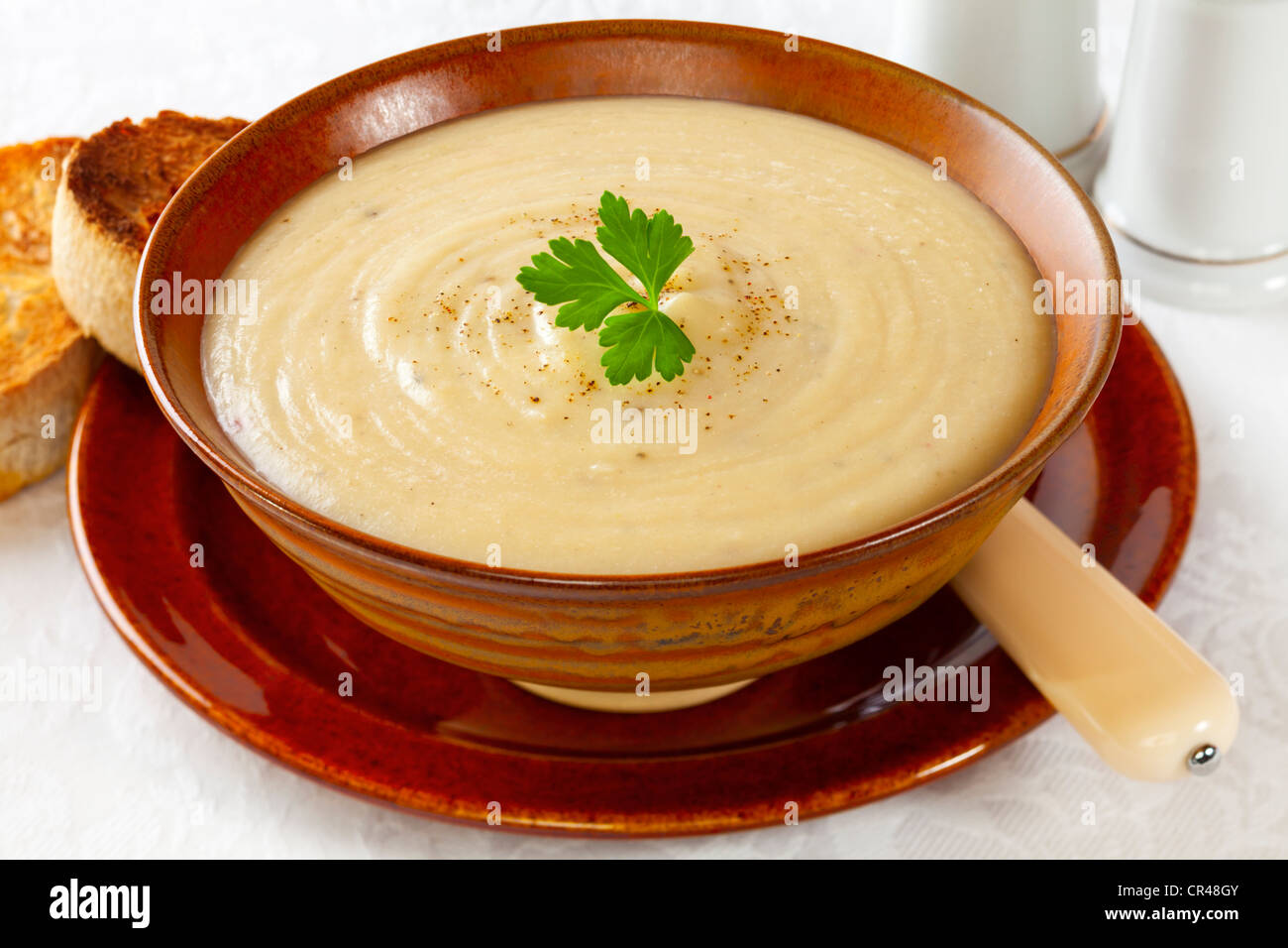Homemade cauliflower and potato soup with a sprinkle of gourmet peppercorns. - Stock Image