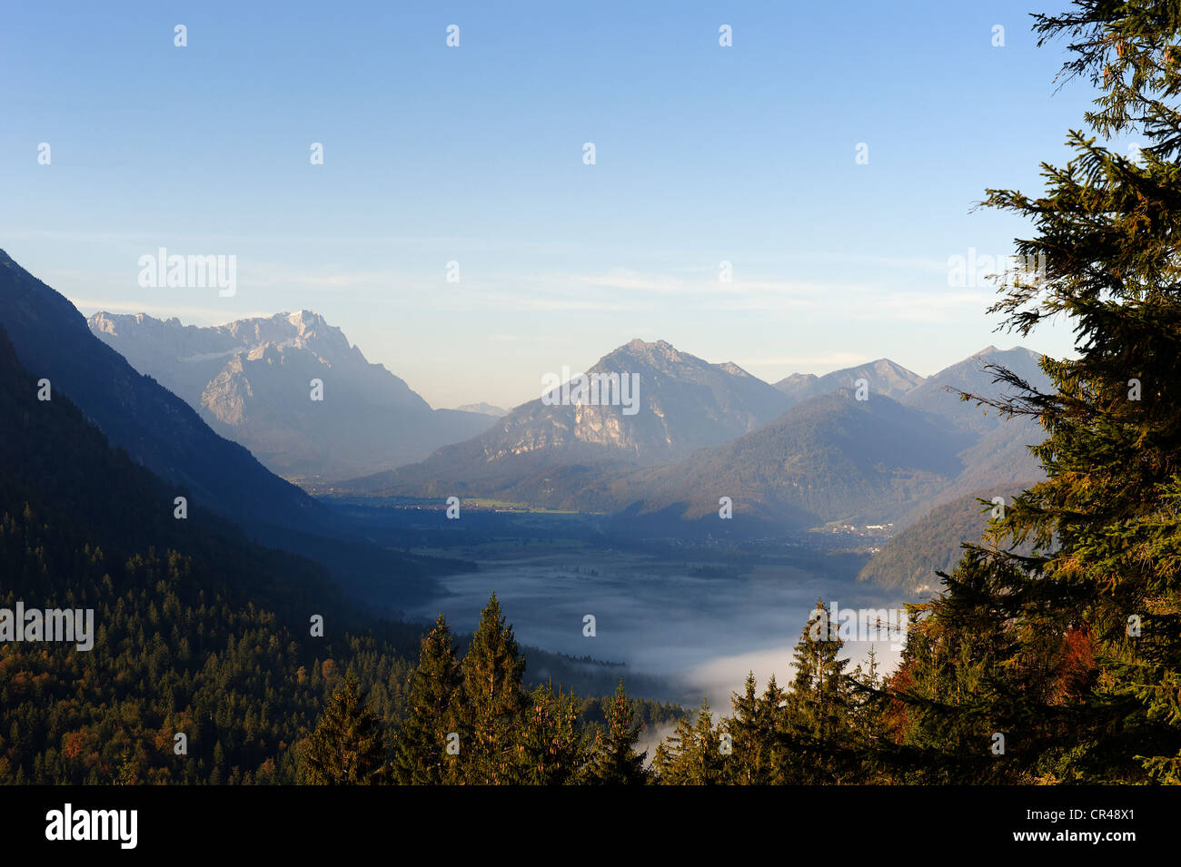 From Osterfeuerkopf, Osterfeuerspitze hill near Eschenlohe, inversion, views across the foggy Loisachtal vally with - Stock Image