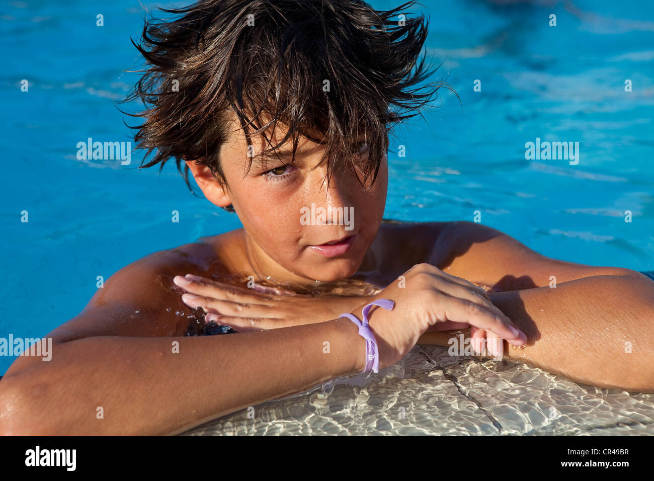 France, Corse du Sud, boy at the swimming pool - Stock Image